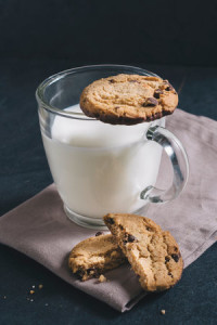 Chip chocolate cookies and glass of milk